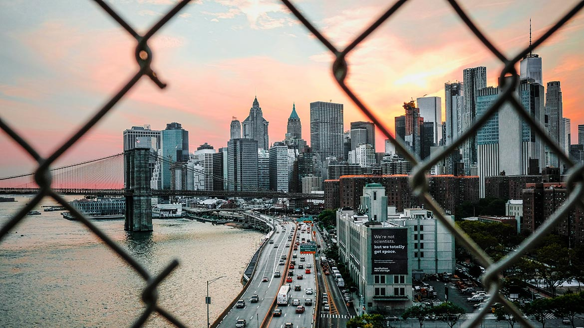 city view through chain link fence