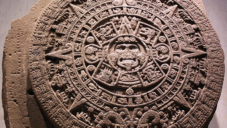 Monolith of the Stone of the Sun, also named Aztec calendar stone (National Museum of Anthropology and History, Mexico City). Wikimedia Commons.