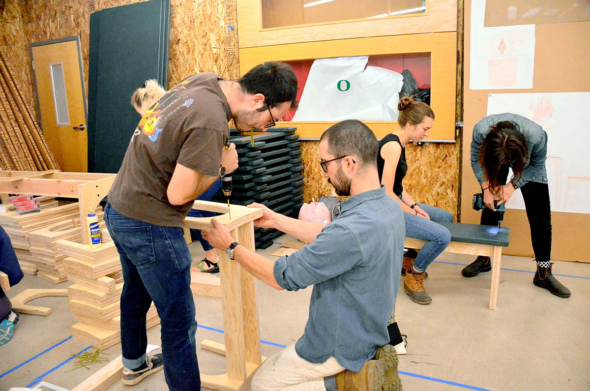 students build furniture for the feast