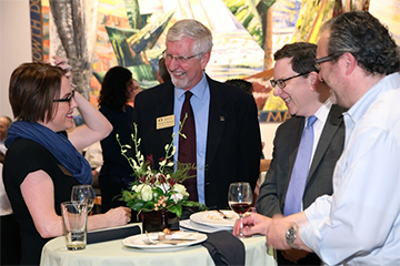 Provost Scott Coltrane and President Michael Schill celebrate with Kate Mondloch