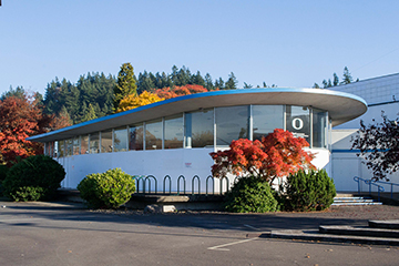 Romania Hall / Lew Williams/Joe Romania Chevrolet dealership. Image courtesy Wikimedia Commons.
