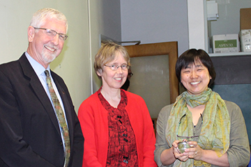 Associate Professor Akiko Walley (right) celebrates her Herman award with Provost Scott Coltrane and Senior Vice Provost Susan Anderson