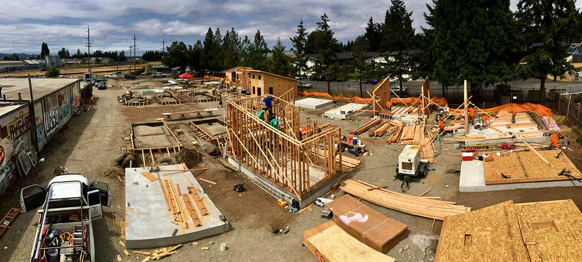Tiny houses under construction in August in Emerald Village. Michael Fifield's design is at center.