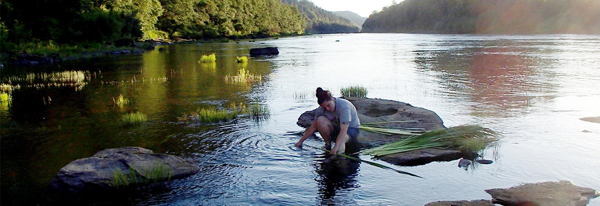 Landscape Architecture student Amanda Craig in a river