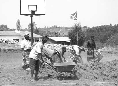 People working in front of a basketball hoop