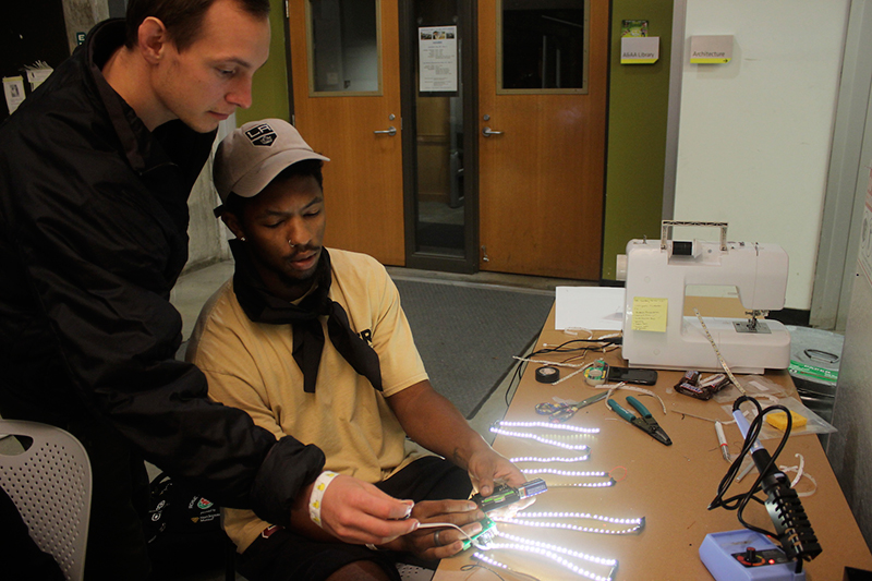 students work with LED light strips