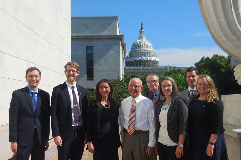 From left, Mugs Scherer, Rory Isbell, Ali Lau, Rep. Peter DeFazio, Robert Parker, Krista Dillon, Bentley Regher, and Amy Nelms