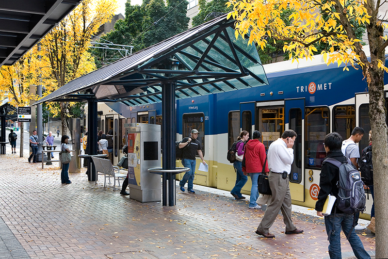 Riders board a MAX light rail train at SW Sixth and Montgomery avenues in downtown Portland. Photo courtesy of TriMet.