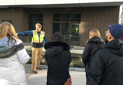 Tom Puttman explains water systems during a studio field trip