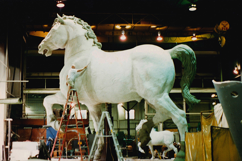 Jay Lindsay on the ladder working on the da Vinci horse.