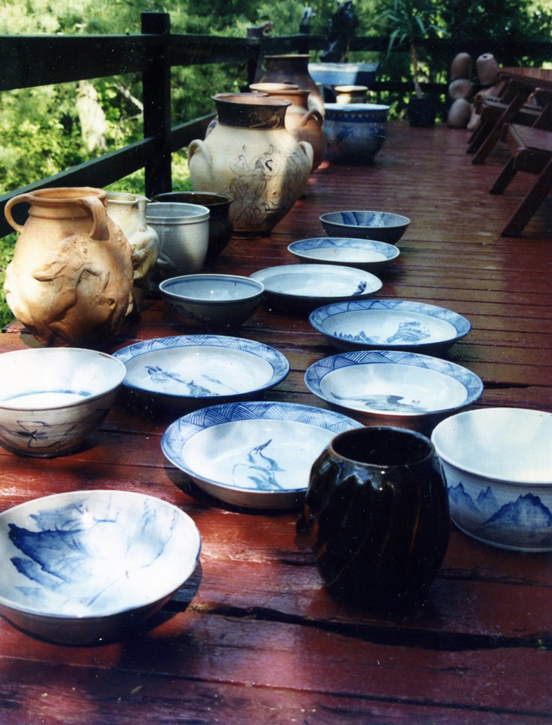 Large glazed pottery sit on Lindsay's deck outside his house in New York.