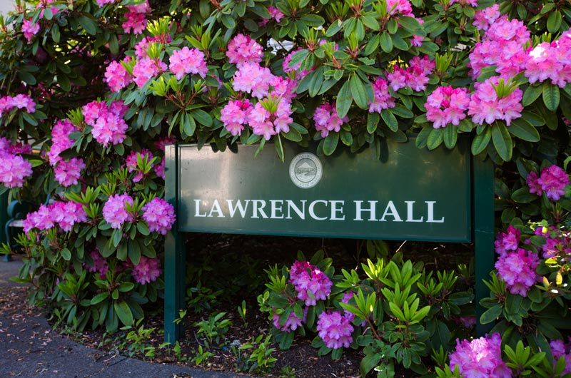 Lawrence Hall building sign with flowers