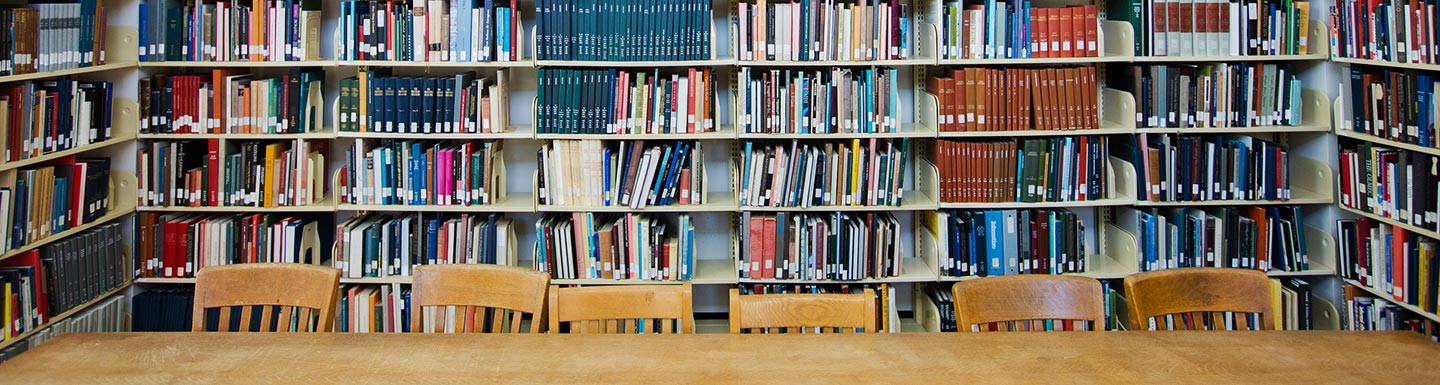 books, chairs and table in library