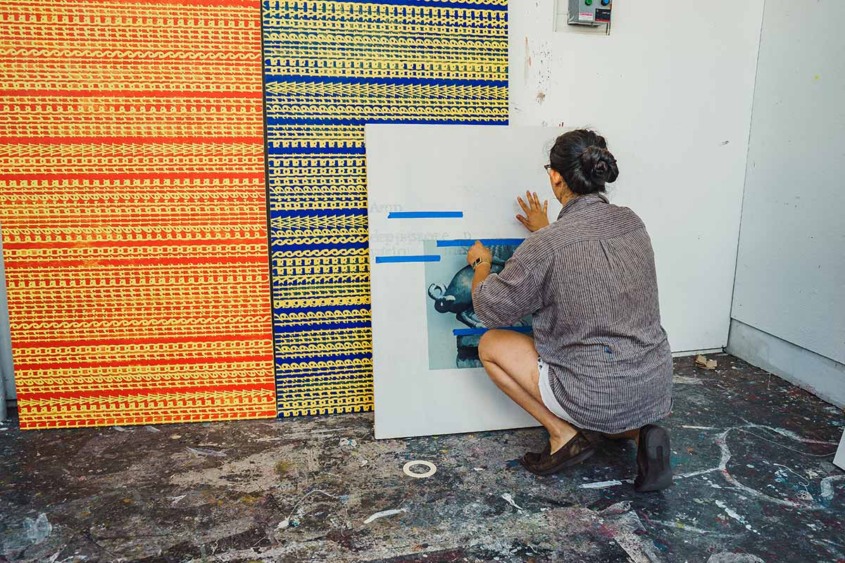 Kathryn Liu prepares artwork for display in 2019 Spring Storm exhibit