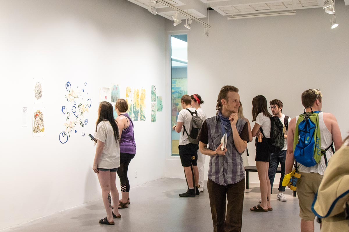 people gather in LaVerne Krause Gallery