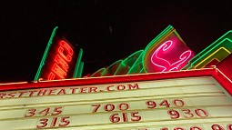 photo of a cinema marquee in neon