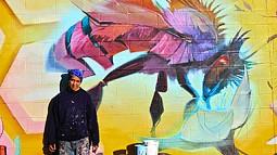 Artist Steve Lopez with Mural