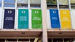 banners hang in the Lawrence Hall courtyard