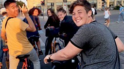 Student Finley Heeb biking with other students in European city