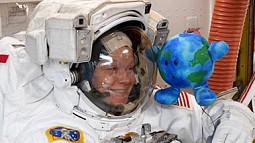 astronaut with earth toy