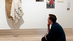 Graduate student Liam Maher looking at art at the MoMA in New York