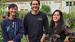 Three students standing at the UO Urban Farm
