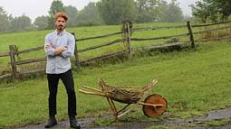 man with a wooden wheelbarrow