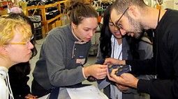 students looking at fabric swatch