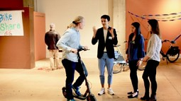 students around a scooter