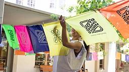 printmaker hangs printed bandanas