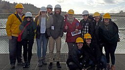 young planning professionals wearing hard hats
